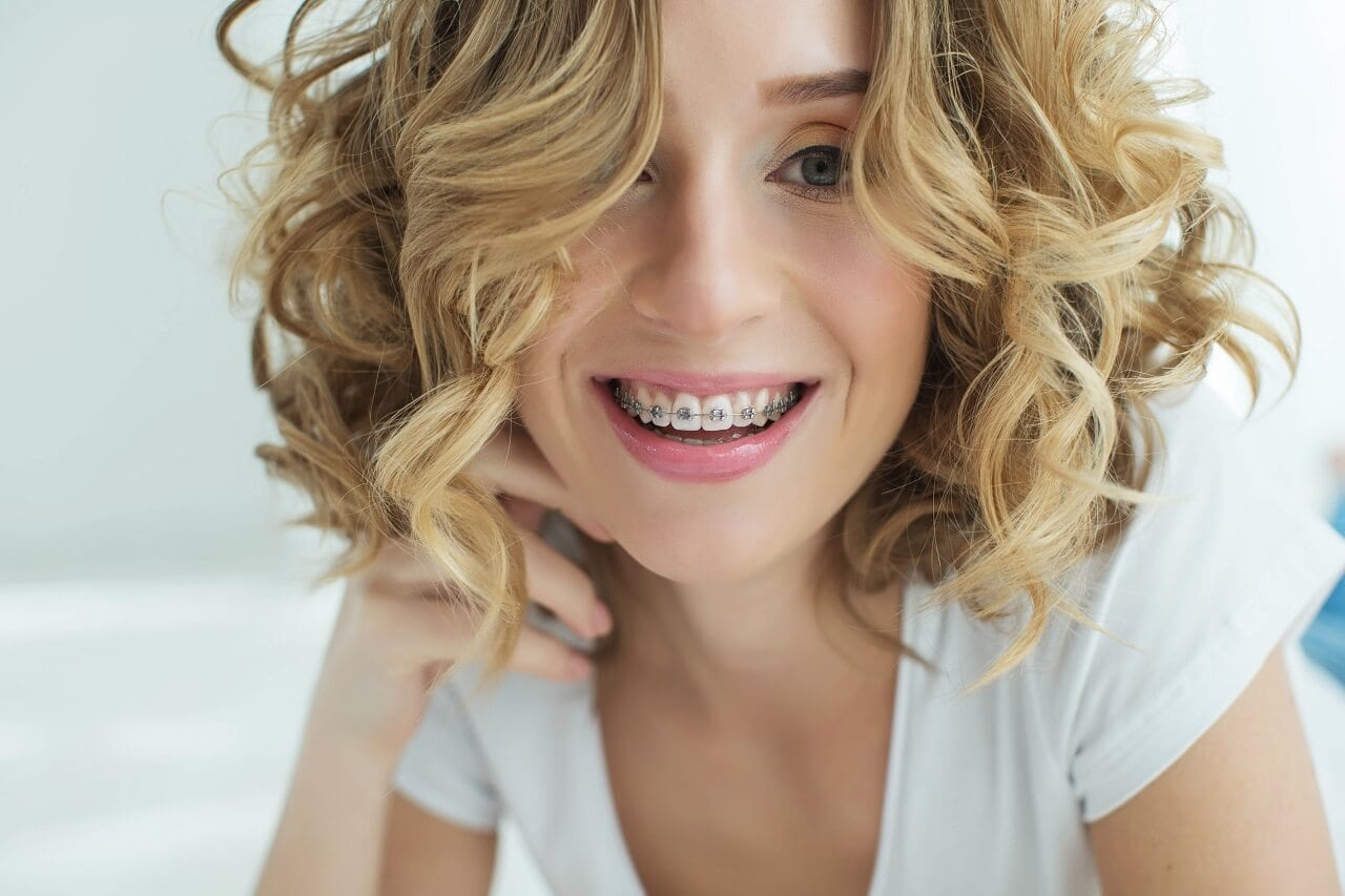 Woman in dental braces smiling for the camera